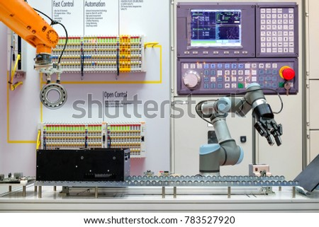 Concept of industrial robotics automation working via conveyor belt on smart factory, terminal and control panel background, industry 4.0