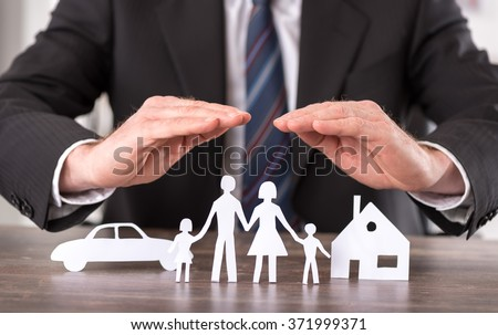 Shutterstock Concept of insurance with hands over a house, a car and a family