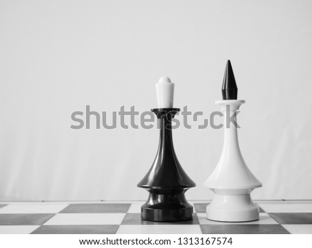 concept of interracial couple with white man and black woman. chessman king and queen on chessboard