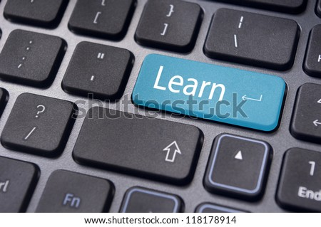 concept of learning, with message on computer keyboard enter button. - stock photo