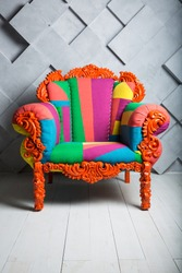 Concept of luxury and success with multi colored velvet armchair, boss place.