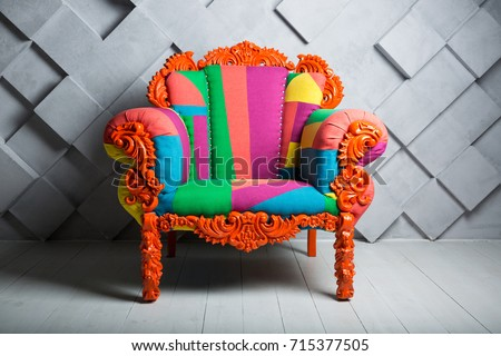 Concept of luxury and success with multi colored velvet armchair, job vacancy.