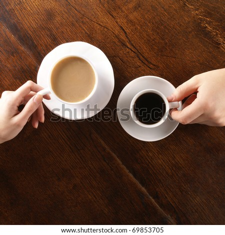 Concept of male and female hands, love and coffee #69853705