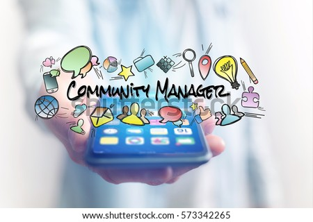 Concept of man holding smartphone with community manager title and multimedia icons flying around #573342265