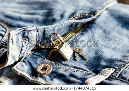 Concept of  marital status  represented by   open zipper with keys and padlock .  Stock photo ©