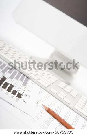 Concept of market share analysis - pencil; graph; sheet with numbers, keyboard and computer