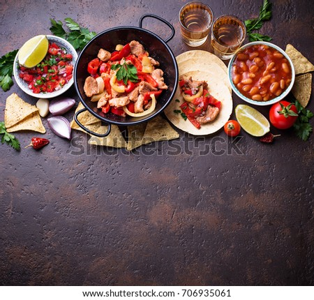 Concept of Mexican food.  Salsa, tortilla, beans, fajitas and tequila. Top view. #706935061