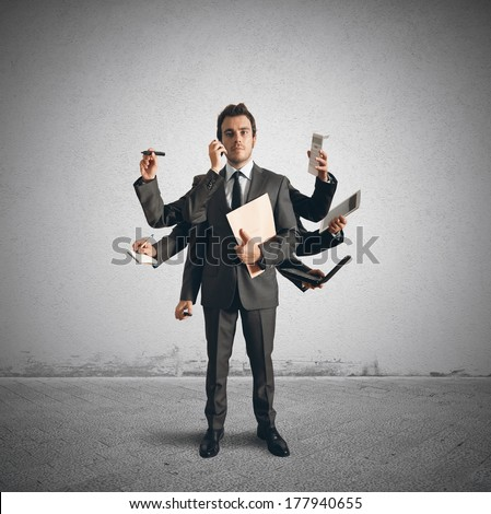 Concept of multitasking with businessman who carries out various operations