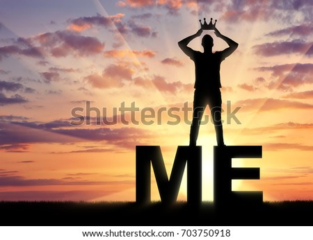Concept of narcissism and selfishness. The silhouette of a selfish and narcissistic man reconciling himself with a crown on the word me Stock photo ©