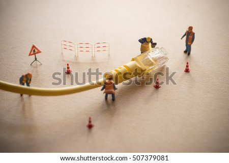 Concept of network troubleshoot supporter or administrator. Internet connection support team fixing LAN cable.