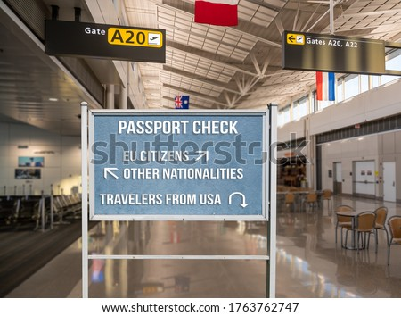 Concept of notice board telling travelers from USA to return home because of coronavirus travel ban into EU or European countries