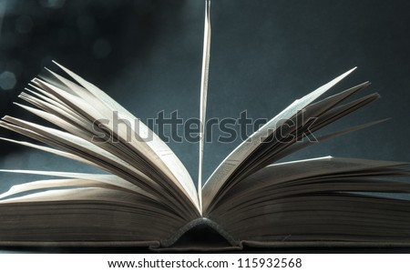 Concept of open book with blue bokeh