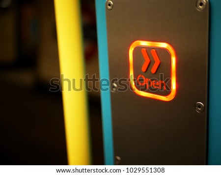Concept of openness shown by lit 'open' sign with orange chevrons on metropolitan line train on london underground, with yellow pole and view to underground symbol on the platform #1029551308