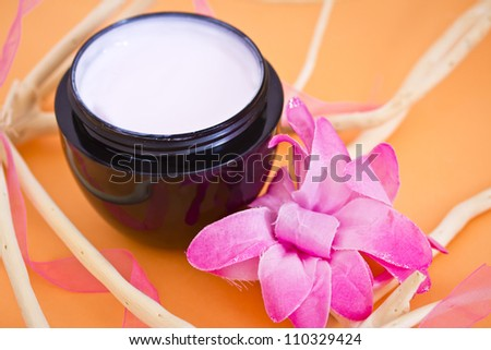 concept of organic cosmetics, beauty product with flower and branches