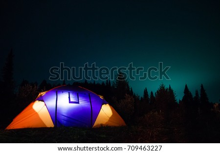 concept of outdoor recreation, night in a tent in the open air. tent nature
