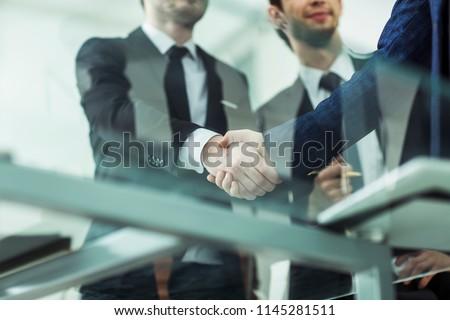 concept of partnership - handshake of business partners #1145281511