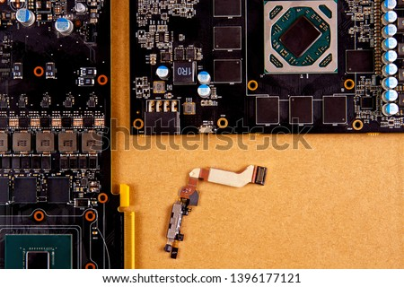 Concept of parts for mobile phones. Mobile board for repair of mobile phones lies  on the background of a cardboard box, spare parts for mobile phones
