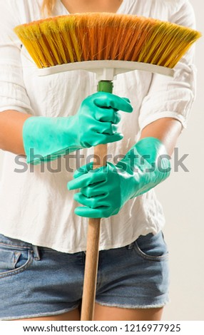 Concept of people, housework and housework: Housewife sweeping with dense bristle broom #1216977925