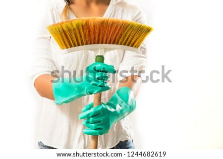 Concept of people, housework and housework: Housewife sweeping with dense bristle broom #1244682619