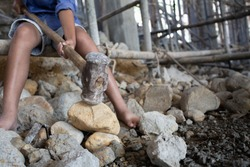 Concept of poverty and child labor, Children who are working on construction sites ,  Against child labor, Poor children,  construction work, Violence children and trafficking concept