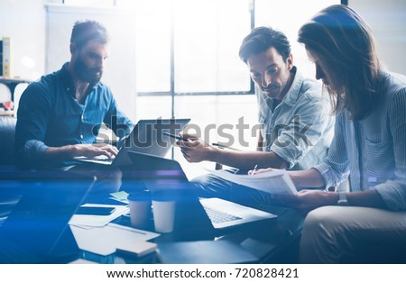 Concept of presentation new business project.Business people using electronic devices.Horizontal, blurred background