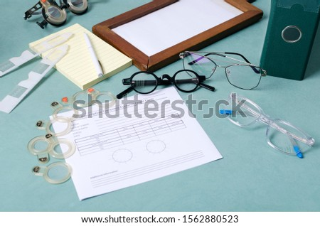 Concept of ptometry and prescription for corrective spectacles. Pair os eyeglasses, blank prescriprion, special instruments for diagnosis eyesight