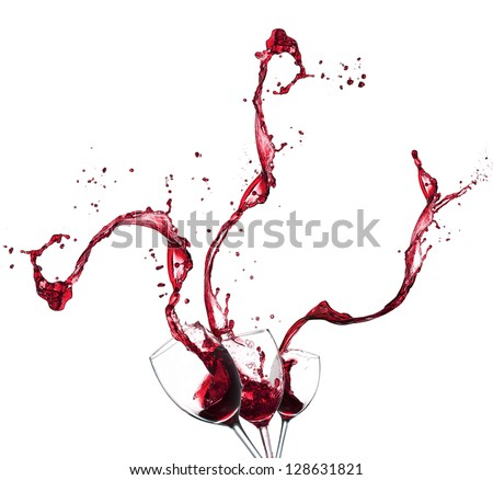 Concept of red wine splashing from glasses, isolated on white background