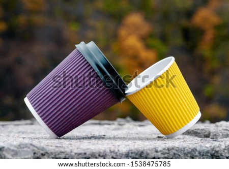 Concept of reliance, friendship, support, relations, male & female, A pair of brown & yellow paper cups, take out, coffee to go. Two eco-friendly heat proof cardboard mugs, close up