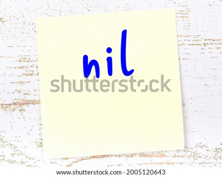 Concept of reminder about nil. Yellow sticky sheet of paper on wooden wall with inscription Stok fotoğraf ©