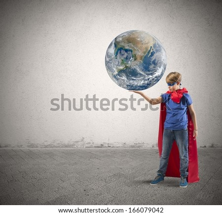 Concept of save the world with young super hero. world provided by nasa