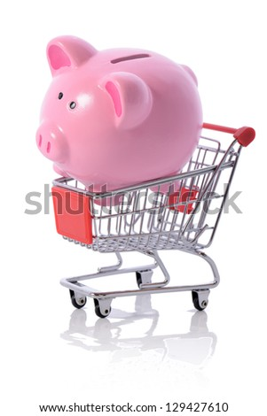 Concept of savings on shopping, piggy bank in a shopping trolley isolated on white - stock photo