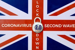 Concept Of Second Lockdown in UK. Real padlock placed on top of Union Jack flag to indicate second national lockdown in UK due to rise in COVID-19 cases