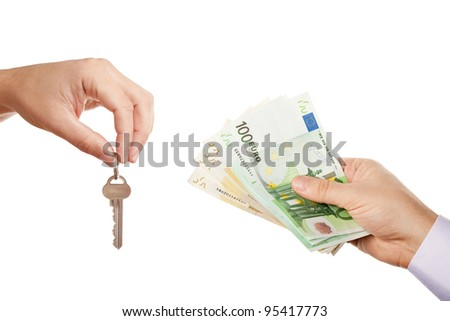 Concept of selling property - two businessmen hands giving each other modern key and cash money (Euro banknotes) while selling/buying or letting/renting real estate, isolated over white background