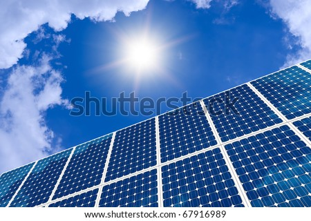 Concept of solar panel and sun - stock photo