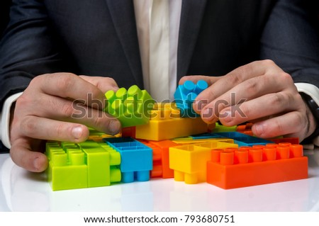 Concept of strategy and reorganization business ideas - young businessman playing with colored toy blocks Foto d'archivio ©