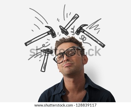 Concept of stressed businessman with hammer