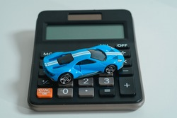 Concept of tax or insurance or rebate; discount; calculator and a car.