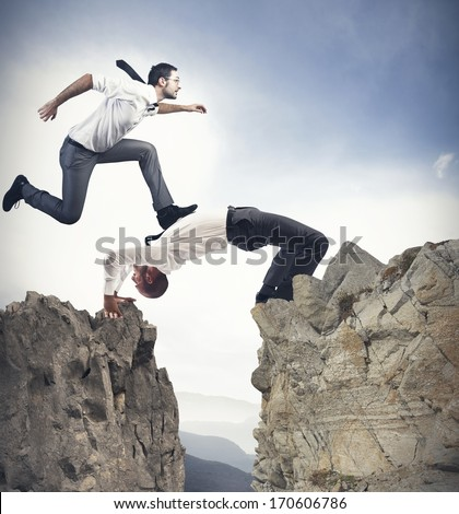 Concept Of Teamwork And Partnership With Businessman Like A Bridge