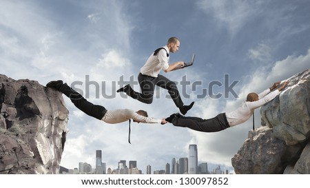 Concept of teamwork with two businessman like a bridge and a running businessmsn