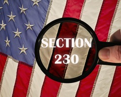 Concept of the american law Section 230 on internet companies. USA flag in the background.