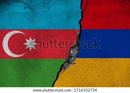 Concept of the Conflict between Armenia and Azerbaijan with painted Flags on a Wall and a Crack between them