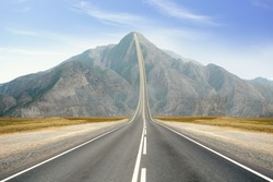 Concept of the road to success. Road Up in the peak of mountain.