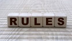 concept of the word RULES on cubes on a beautiful background. Business concept.