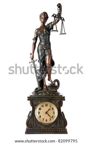 Concept of time for Justice: Themis, mythological Greek goddess, blind and holding empty balance and sword in hands, standing on defeated snake and book, a table clock, isolated on white background