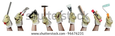 concept of tools in hands with gloves