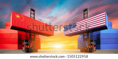 Concept of trade War. Trade confrontation. The landing of containers. Economic trade war. Freight transportation. Cargo containers flags hoisted by crane hooks on blue cloudy sky background