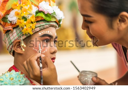 concept of Traditions Lanna novice monk tradition after having broken the head, must wear traditional style, draw eyebrows, red eyes, put on bracelets, necklace, Sangkhathan and pray for adult parade. #1563402949