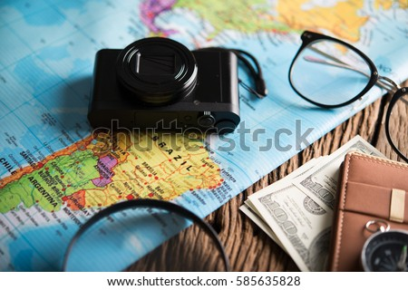 Concept of travel - View of Traveler magnifier,camera eyeglasses money and items, Travel and Holiday on world map background vintage tone. - Shutterstock ID 585635828