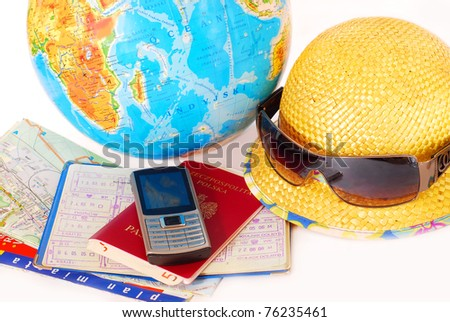 concept of traveling all over the world with mobile phone,passport,money,map and globe isolated on white