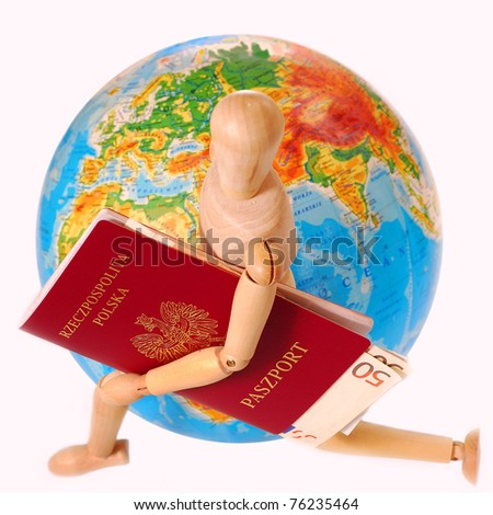 concept of traveling all over the world with wooden figure holding passport and  running around the globe isolated on white